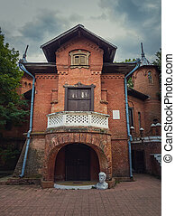 The Hunting Castle facade, Manuc Bei mansion, architectural, culture and historic complex of Hincesti city, Moldova. Ancient brick building. Halloween haunted house theme concept, ghost home or manor.