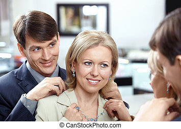 The husband with wife in shop