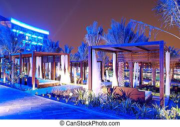 The huts near swimming pool at modern luxury hotel, Palm Jumeirah, Dubai, UAE
