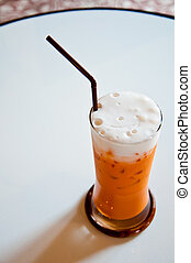The iced tea with milk as Thai style as background