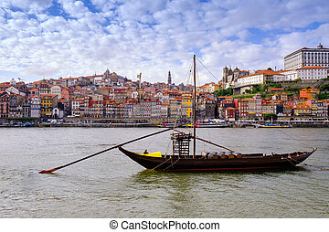 The iconic Rabelo boats, traditional Port wine transport on Douro river, Porto, Portugal