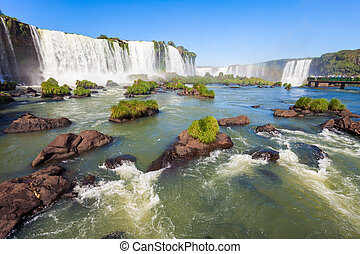 Iguazu Falls (Cataratas del Iguazu) are waterfalls of the Iguazu River on the border of the Argentina and the Brazil. Iguazu are the largest waterfalls system in the world.