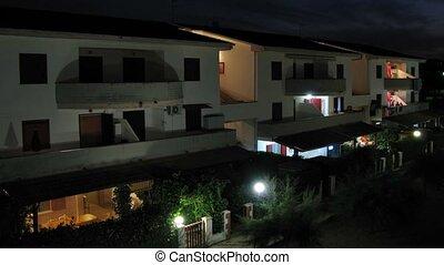The illuminated house in night in Italy. - The illuminated...