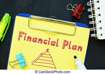 The image contains the inscription Financial Plan on a notepad sheet.