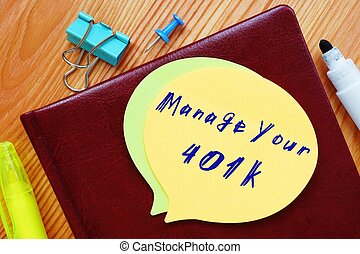 The image contains the inscription Manage Your 401k on a notepad sheet.