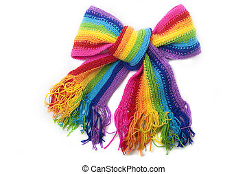 The image of a bright rainbow knitted scarf