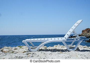 chaise longue at a sea beach