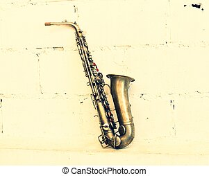 The image of a saxophone (vintage stye)