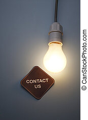 contact us - The image of a shone electric bulb with contact...