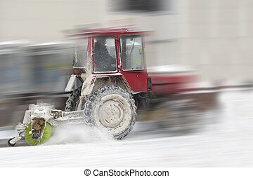 tractor shoveling the snow