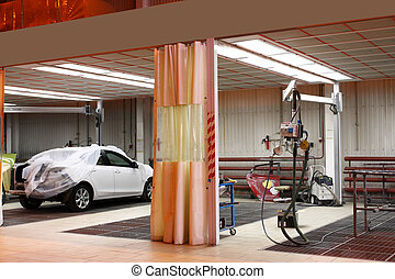 body shop - The image of cars stand under repair in body...