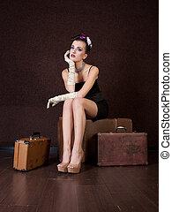 girl sits on a bag