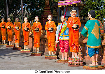 The image of monks in a Buddhist Temple in Sihanouk Ville, Cambodia.