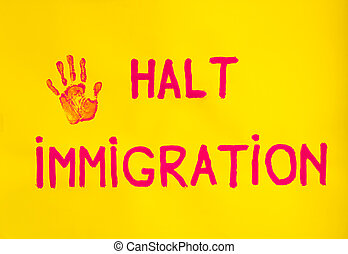 halt immigration - the imprint of a hand held along with the...
