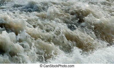 increasing flow of raging waterfall - The increasing flow of...