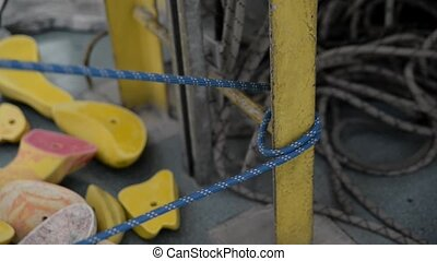 The industrial climber fastens unloading before working at ...