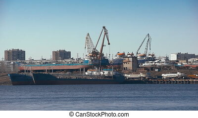 The industrial part of the coast. View of the Shipyard from the river.