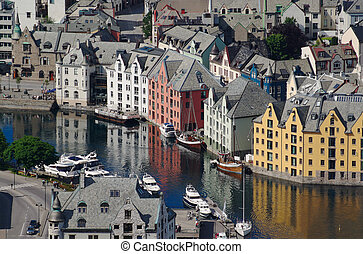 The inner harbour of the Norwegian port town of Aalesund. After a fire in the year 1904 the city was build up again in the architectural style of Art Nouveau (Jugendstil), which it is famous for.