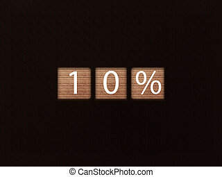The inscription 10% on wooden blocks on black background. Letter text on wooden cube.