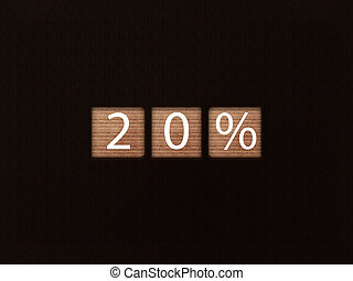 The inscription 20% on wooden blocks on black background. Letter text on wooden cube.