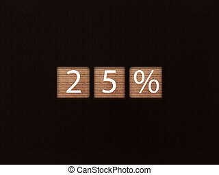The inscription 25% on wooden blocks on black background. Letter text on wooden cube.