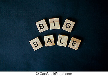 The inscription big sale from wooden blocks
