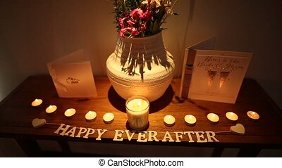"""The inscription """"Happy Ever After"""" on the table and the..."""