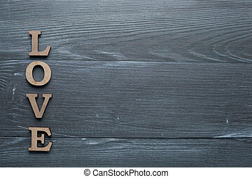 The inscription love is laid out in wooden letters