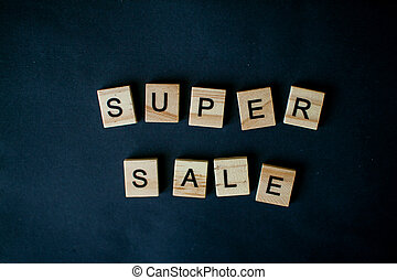 The inscription super sale from wooden blocks