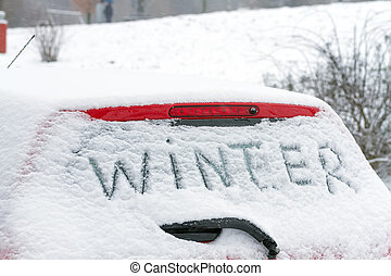 "The inscription ""Winter"" on a car windshield."