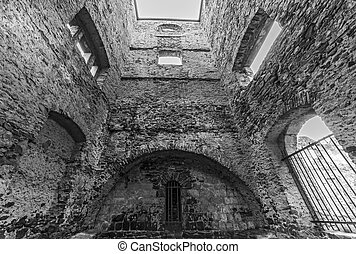 the inside of empty ruined stone tower - black and white...