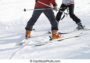 The instructor teaches skiing