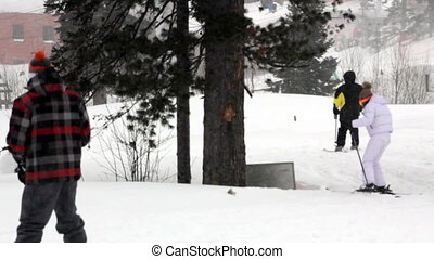 The instructor teaches the skier to ride at the bottom of the hill
