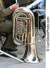 The instrument of the brass band tuba