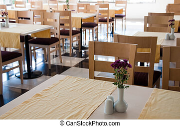 The interior of a cafe with wooden tables