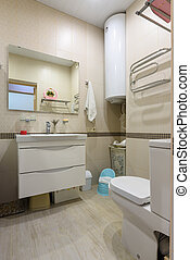 The interior of a compact toilet room in an apartment