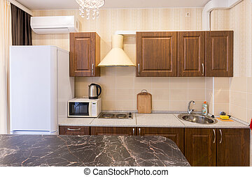 The interior of a modern budget kitchen in a newly built apartment