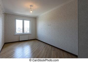 The interior of a rectangular rectangular bedroom without furniture