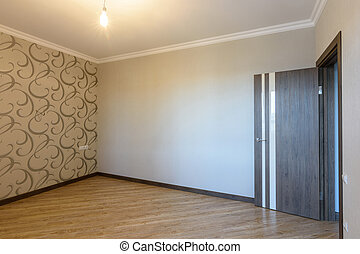 The interior of a small bedroom after being renovated without furniture