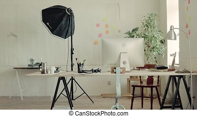 The interior of an empty modern office or a studio. - The...