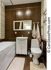 The interior of the bathroom is made in a classic style