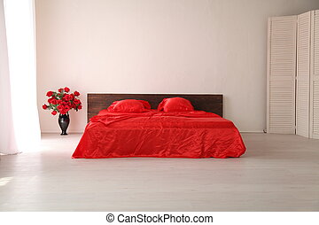 the Interior of the white room with a bed with red