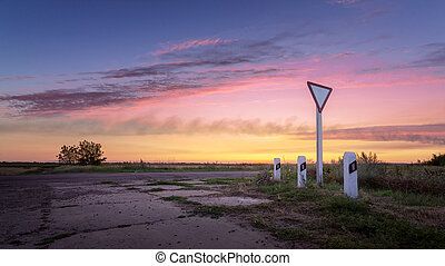 the intersection at sunset - countryside colourful landscape...