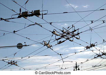 The intersection of several tram and trolleybus wires. ...