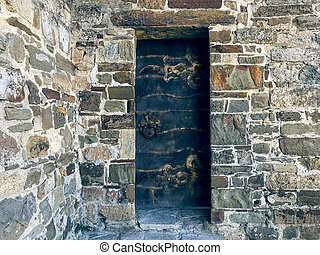 The iron door in a stone wall