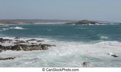The island Ilha do Pessegueiro during the big waves and the...