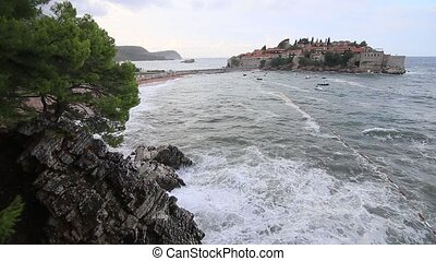 The Island of Sveti Stefan. Storm on the beach. Montenegro