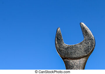 The Isolated Wrench with the Blue Sky Background