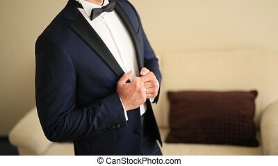 The jacket on the man is close-up. The bridegroom at the...