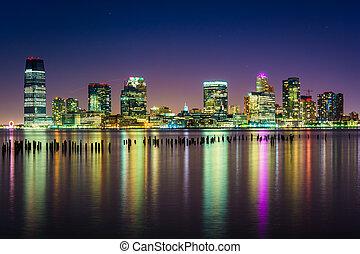 The Jersey City Skyline at night, seen from Pier 34, Manhattan,